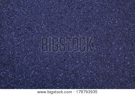 Dark violet colored surface abstract texture background