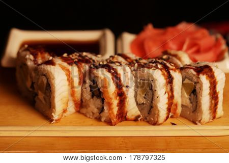 Japanese rolls with eel on a wooden plank, asian restourant