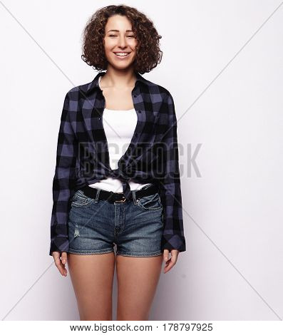 lifestyle and people concept:Young happy woman with curly hair over white background