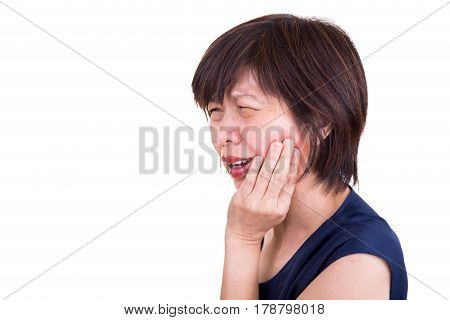 Asian Woman In Intense Toothache Pain With Hands Over Face