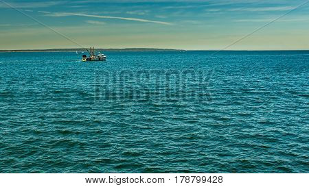 A fishing boat makes it way across Vineyard Sound from Falmouth towards Marthas Vineyard south of Cape Cod.