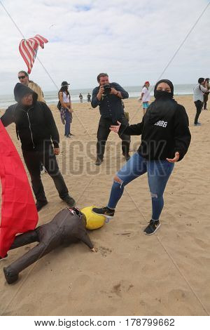 Huntington Beach, CA - March 25 2017: Make America Great Again March. Protesters of republican president Donald Trump, are arrested for starting fights at a MAGA March in Huntington Beach.