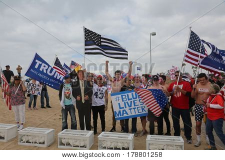 Huntington Beach, CA - March 25 2017: Make America Great Again March. Supporters of republican president Donald Trump, release white doves and wave flags, at a MAGA March in Huntington Beach.