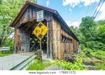 The Coombs Covered Bridge is a wooden covered bridge which carries Coombs Bridge Road over the Ashuelot River in northern Winchester New Hampshire.