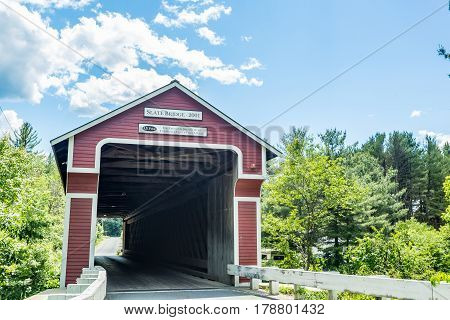 The Slate Covered Bridge is a wooden covered bridge which carries the Westport Village Road over the Ashuelot River in Westport a village of Swanzey New Hampshire.