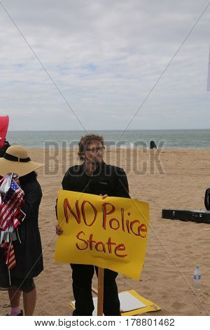 Huntington Beach, CA - March 25 2017: Make America Great Again March. Protesters of republican president Donald Trump, try to disrupt and argue with supporters at a MAGA March.