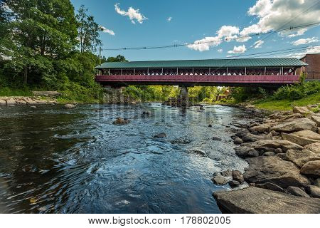 The West Swanzey Covered Bridge (also known as the Thompson Bridge) is a historic wooden covered bridge carrying Main Street over the Ashuelot River in West Swanzey New Hampshire.