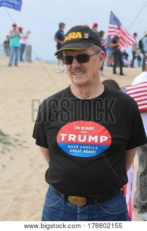 Huntington Beach, CA - March 25 2017: Make America Great Again March. Thousand of Supporters of republican president Donald Trump, march and wave flags, at a MAGA March in Huntington Beach.