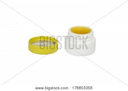 Small jar of ointment isolated on a white background.