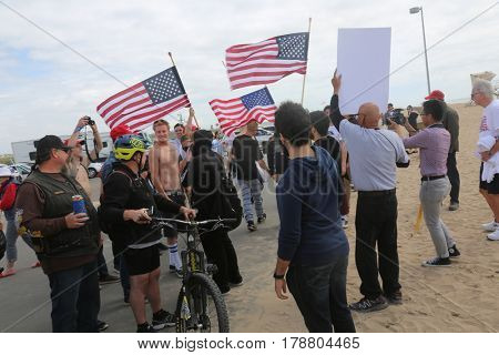 Huntington Beach, CA - March 25 2017: Make America Great Again March. About 30 Protesters try to disrupt a republican president Donald Trump, march and wave flags, at a MAGA March in Huntington Beach.