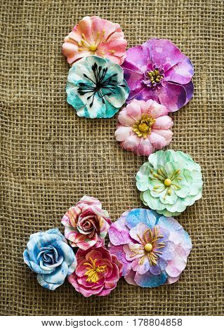 Spring Paper Flowers On Sack Texture