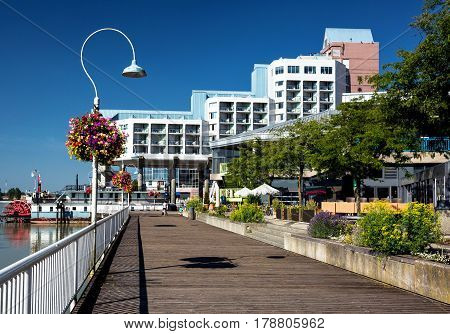 Promenade  quay and a hotel on the  riverfront of Fraser River  in New Westminster city