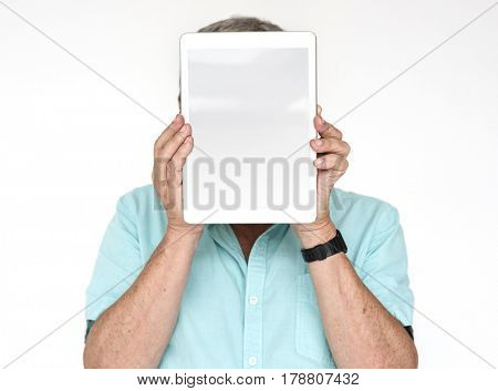 Man holding digital tablet on his face