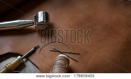 Leather Crafting Tools on Leather and Wood