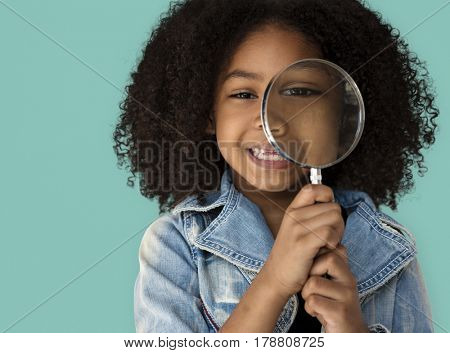 Little Girl Holding Magnifying Glass Smiling