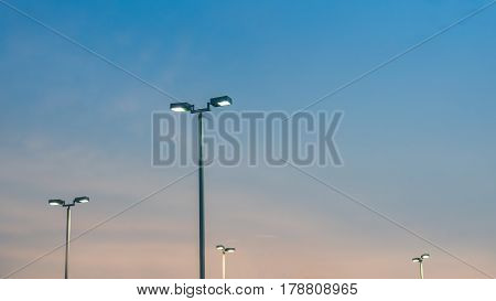 Modern Street Light Poles at Sunset Background