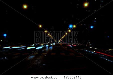 Cars blurred in motion at night street scene