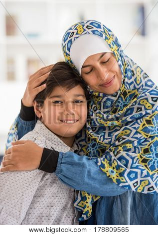 Arabic woman and her child at home