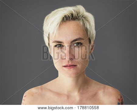 Portrait of woman shirtless looking at camera