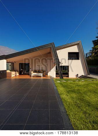 Modern villa, exterior with lawn