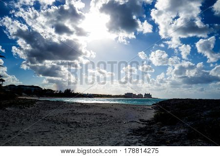 A cloudy view of a far away castle with a lot of sunlight near the beach. New Providence, Nassau, Bahamas.