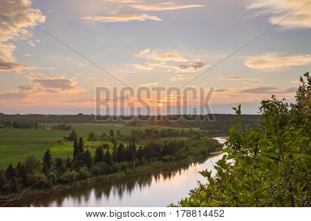 Landscape of the sun setting above the Red Deer river in Red Deer Alberta.