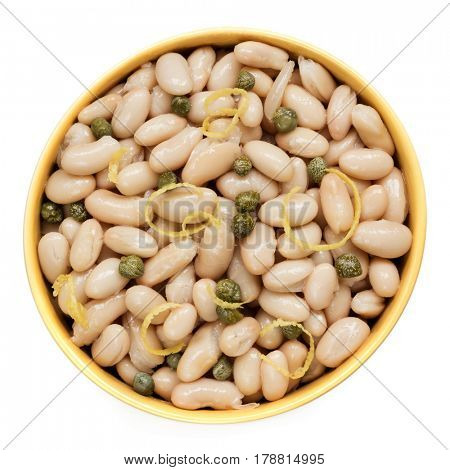 Cannellini beans with capers and lemon zest.  Top view, isolated.