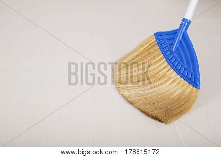 broom on for cleaning the floor background