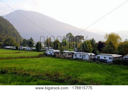 Travel To Sankt-wolfgang, Austria. The Camping On The Green Field In The Mountains.