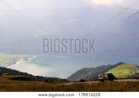 Travel To Sankt-wolfgang, Austria. The Road With View On The Mountains And A Lake In The Clouds.