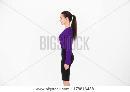 Posture concept. Young woman on white background