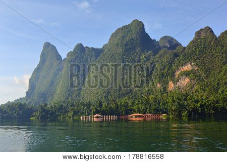 Cheow Lan lake landscape with floating houses, National Park Khao Sok, Thailand
