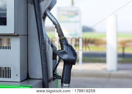gas pump nozzle hangs on gasoline pump