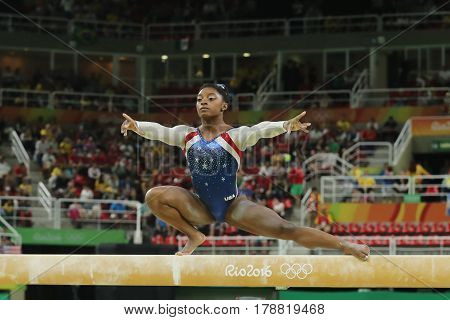 RIO DE JANEIRO, BRAZIL - AUGUST 11, 2016: Olympic champion Simone Biles of United States competes on the balance beam at women's all-around gymnastics at Rio 2016 Olympic Games