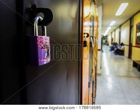 Padlock of cherry blossom tree and hallway of lockers