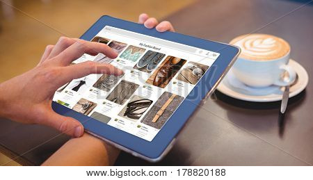 Composite image of website page against close-up of digital tablet and coffee on table Close-up of digital tablet and coffee on table in the coffee shop