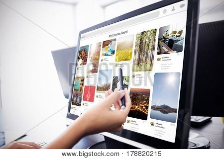 Composite image of website page against casual businesswoman touching her computer Casual businesswoman touching her computer with a pen