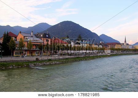 Travel To Sankt-wolfgang, Austria. The View On A City And A River With The Mountains On The Backgrou