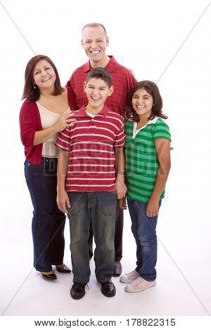 Happy Hispanic family portrait smiling isolated on white background.