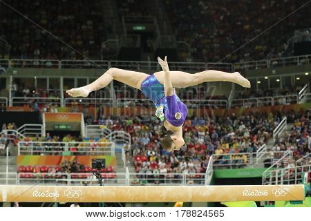 RIO DE JANEIRO, BRAZIL - AUGUST 11, 2016: Rhythmic gymnast Aliya Mustafina of Russian Federation competes on the balance beam at women's all-around gymnastics at Rio 2016 Olympic Games