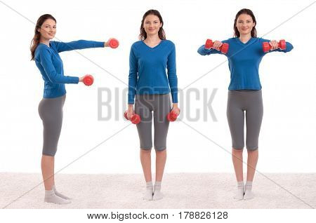 Young female model holding dumbbells and forming text: FIT