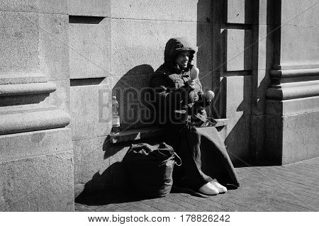Madrid Spain - September 18 2016: Unidentified man beggar asked for money on a busy street in the center of Madrid