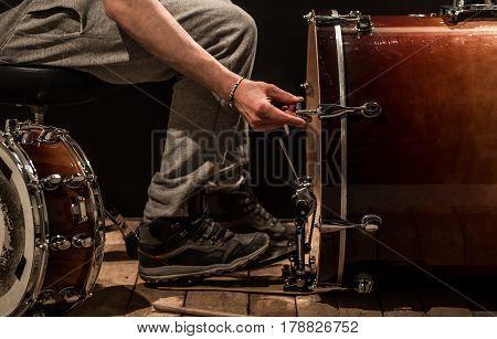 Man Adjusts Percussion Instruments, Creative Music Concept
