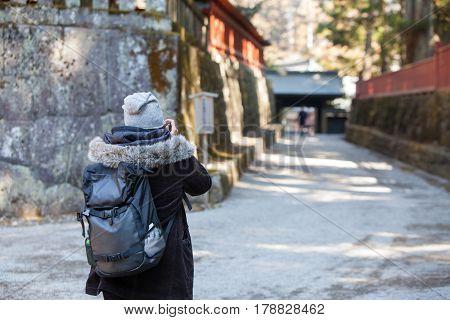 Woman traveler take photo landscape in Nikko nation Park