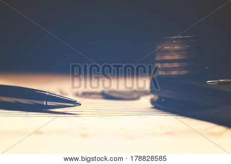Pen And Calculator With Thailand Coin On Paperwork, Summary Report And Financial Analyzing Concept.