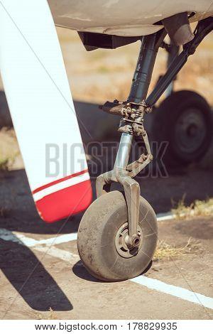 Front landing gear of aircraft closeup view. Small sport airplane propeller