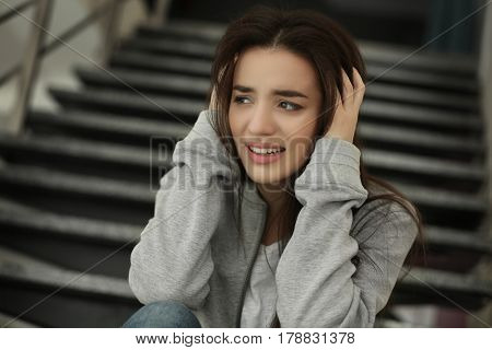 Depressed young woman indoors