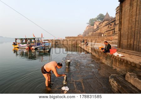 Indian Man Performs Pooja On Sacred River Narmada In Maheshwar