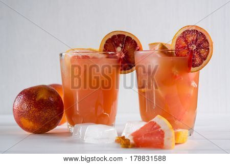 Detox  refreshing cocktail from grapefruit and sicilian orange with ice. Summer drink.