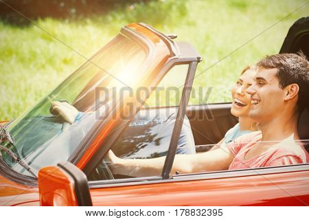 Couple having fun in a red car